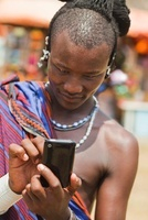 Masai Man in Traditional Dress Using Cell Phone, Zanzibar, T