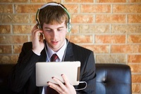 Model and Property released. Businessman 20's with headphone