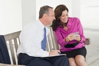 Business Couple Sitting on Bench