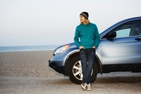 Man with Car at Beach