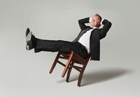 Businessman Leaning Back on Chair 20025309817| 写真素材・ストックフォト・画像・イラスト素材|アマナイメージズ
