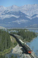 Canadian National Railways goods train along Athabasca River, Jasper National Park, UNESCO World Heritage Site, Alberta, Rocky M