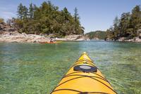 Woman Sea Kayaking, Desolation Sound, British Columbia, Canada