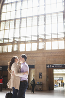 Couple Kissing in Train Station