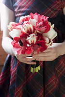 Close-Up of Girl Holding Bouquet of Flowers