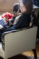 Girl with Bouquet of Flowers Sitting in Chair