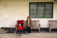 Woman on Bench with Baby in Stroller