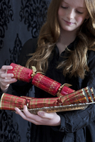 Girl Holding Tray of Christmas Crackers