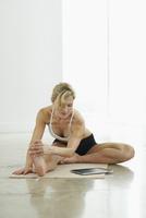Woman with iPad Doing Yoga