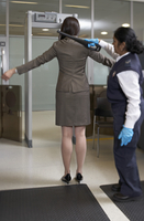 Businesswoman Going Through Security Check at Airport