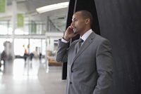 Businessman Using Cell Phone in Airport