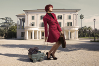 Woman with Briefcase and Toy Carriage