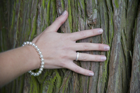 Bride with Hand on Tree Trunk