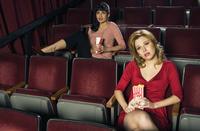 Women Watching Movie in Theatre