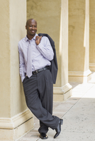 Portrait of Businessman Leaving Against Column