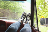 Woman's Feet on Dashboard of Car