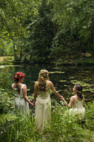 Three Women Holding Hands by Pond