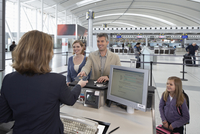 Family at Ticket Counter in Airport
