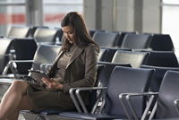 Businesswoman Using Tablet Computer in Airport