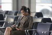 Businesswoman with Computer Tablet in Airport