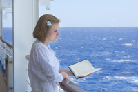 Teenage Girl Reading Book on Cruise Ship