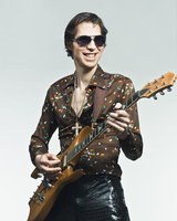 Portrait of Rock Star Playing Guitar