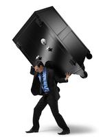 Businessman Carrying Large Safe on his Back