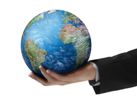 Close-Up of Businessman Holding Globe in Hand