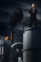 Businesswoman Standing on top of Industrial Building at Night