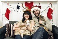Couple with Pets in Christmas Portrait