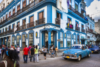 Blue Building, Classic Car, and Busy Street Scene, Havana, Cuba
