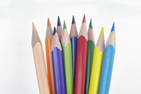 Close Up of Ten Multi-Colored Pencil Crayons on White Background