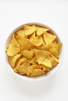 Tortilla Chips in White Bowl on White Background