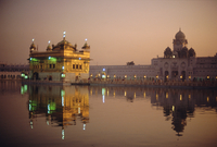 Dusk over the Holy Pool of Nectar looking towards the clocktower and the Golden Temple, Sikh holy place, Amritsar, Punjab State,