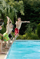 Four Kids Jumping Into Swimming Pool