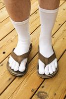 A man wearing flip flops with socks