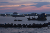 Fishing boats at sunset in port city of Myeik in southern Myanmar