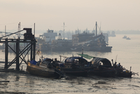 Fishing boats in morning light in the harbour city of Myeik in southern Myanmar