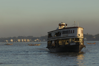 Commuter ferry boats in port at sunset, Ayeyarwady river, Yangon, Myanmar
