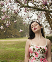 A young woman standing under a magnolia tree in Louisiana