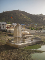 disused water tank with small temple, Bundi, India