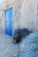 Fishermen's nets and a typical blue door on Es Pujols seafront, Formentera, Balearic Islands, Spain