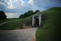 A ceremonial earth lodge at Ocmulgee National Park, Macon, Georgia. These earth mounds were built by carrying earth in bags by h