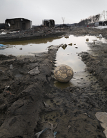 Abandoned ball in burnt out wasteland, Saint Denis, France