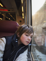Boy looking out window of a train, France