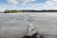 Winter ice retreating from lake, Lake of Two Rivers, Algonquin Provincial Park, Ontario, Canada