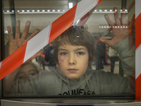 young boy behind blocked door in parisian subway, Paris, France