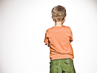Back of boy against a white background