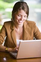 Businesswoman using Laptop Computer, Bradford, Ontario, Canada