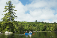 Canoesists on Smoke Lake, Algonquin Provincial Park, Ontario, Canada
